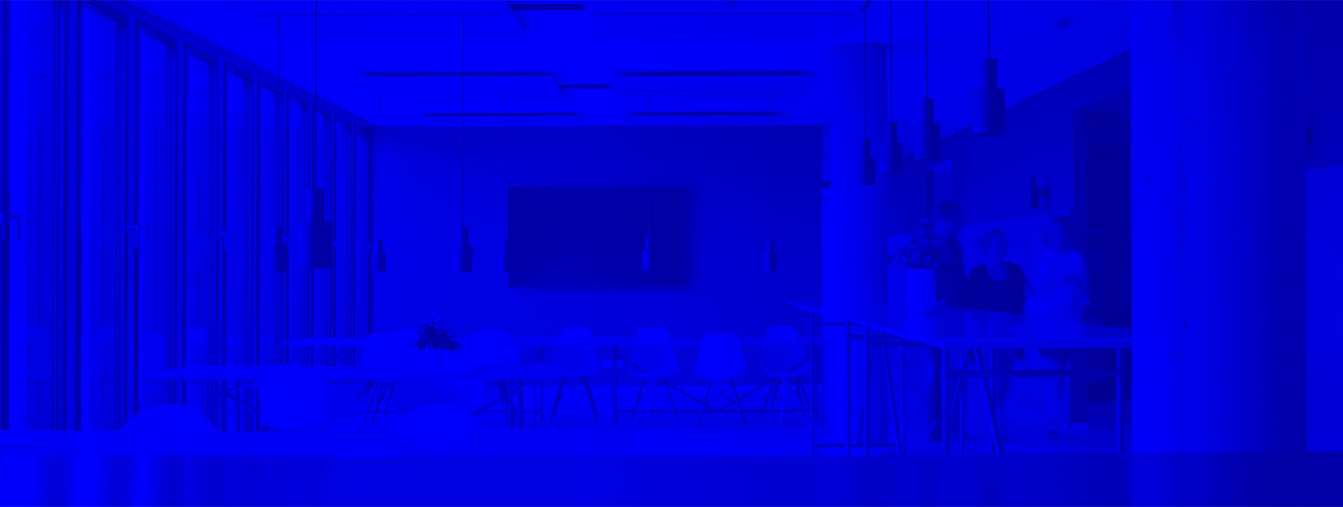 Room with white tables and chairs, on the right side three people are walking through the picture, blue filter