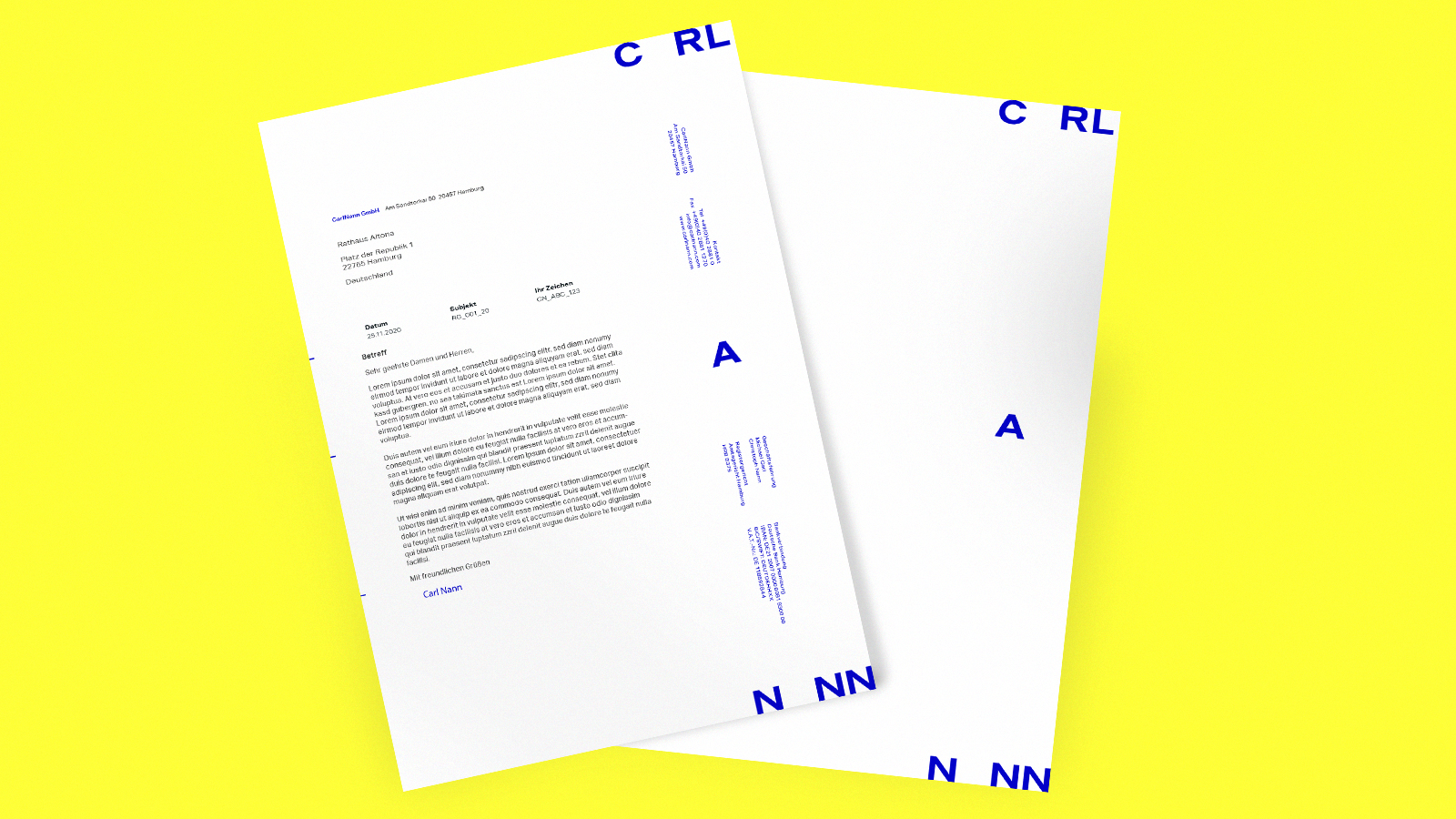 CarlNann Logo on documents on yellow background