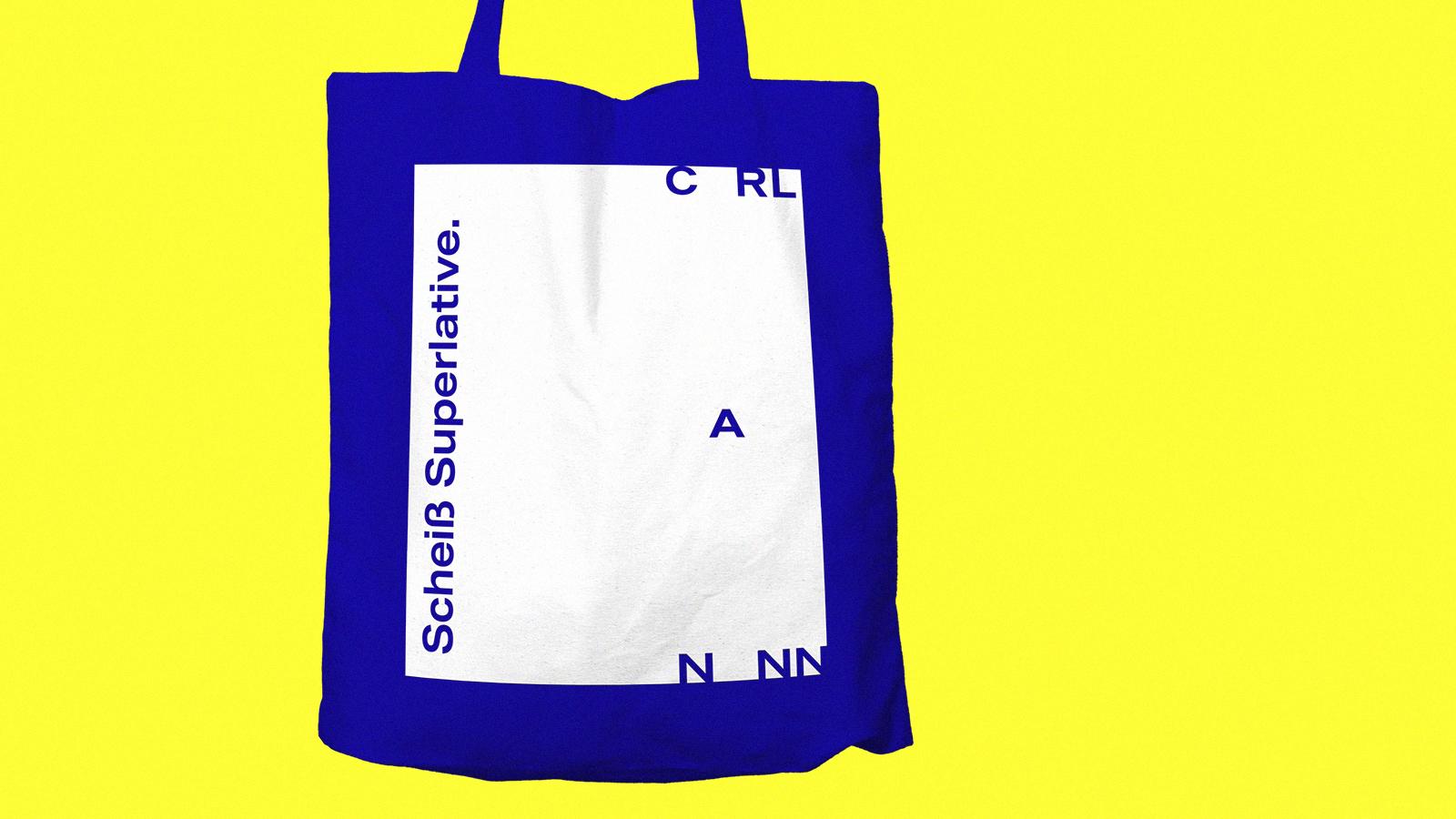 blue CarlNann Jute bag on blue background