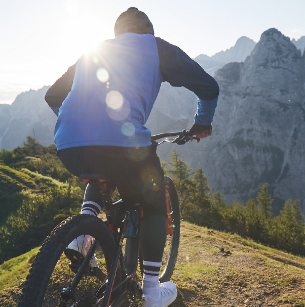 Man riding a bicycle in the mountains
